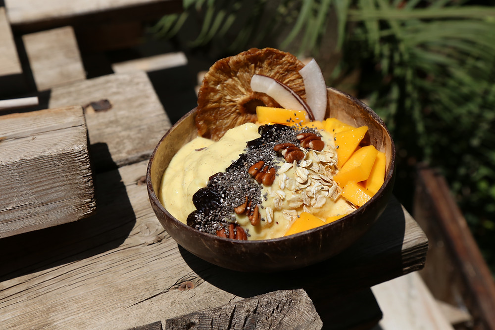 Spiced Mango Pina Colada smoothie bowl from the spiced islands by Amber Houbara