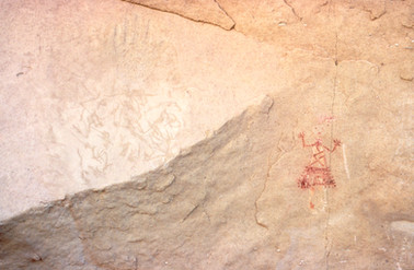 Yei in delgado Canyon with hand and light beings