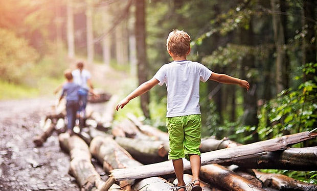 Group-of-kids-playing-in-the-woods.jpg