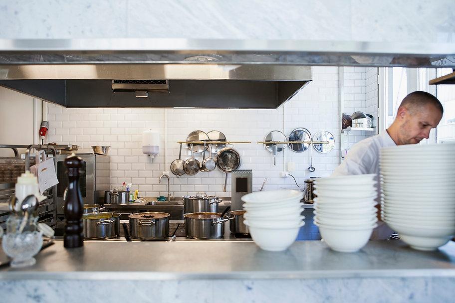 chef-working-at-restaurant-kitchen-8HR47