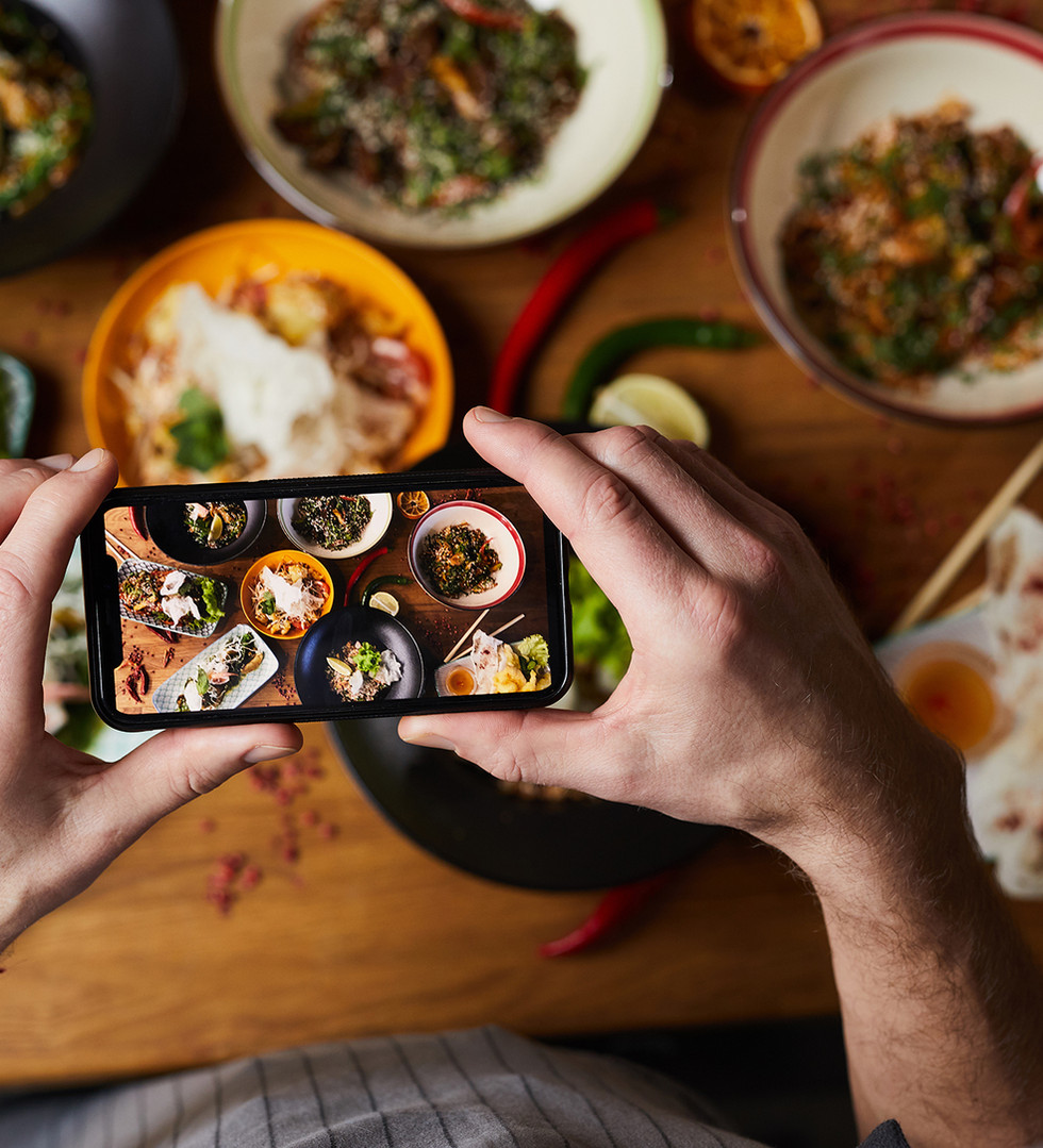 chef-taking-photo-of-asian-food-6ZXEJPV.