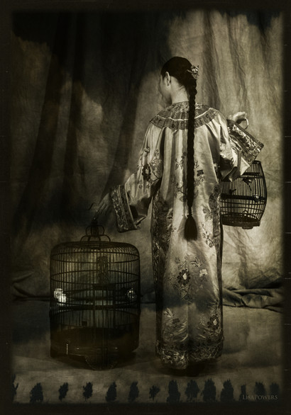 The Seller of Caged Birds
