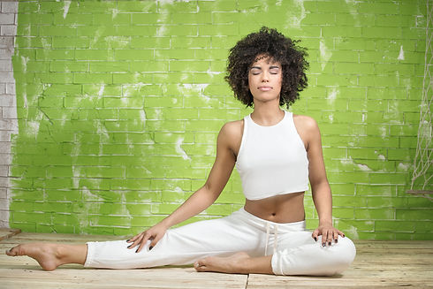 Young afro american woman meditating. Sp