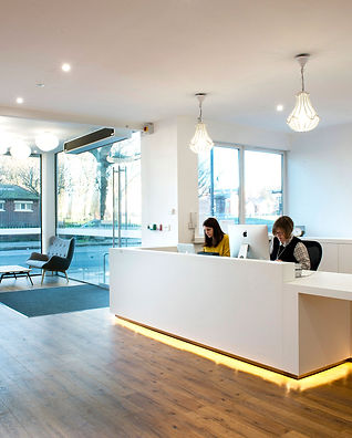 office interior design by Standing Space in Warrington - reception area white style