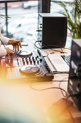 photo-of-person-holding-dj-controller-14