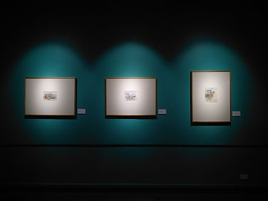 three-paintings-hanging-in-gallery-16740