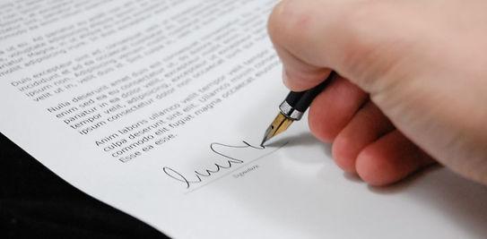 Signing Image.jpg