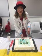 Melissa cutting M.I.R.T.H. Unit's 25th anniversary cake.