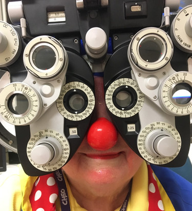 Clowns having eyes checked by famous Dr.