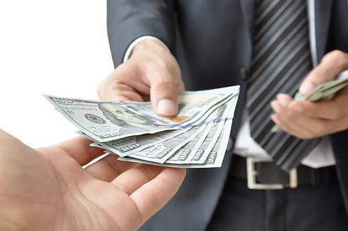 hands-giving-receiving-money.webp