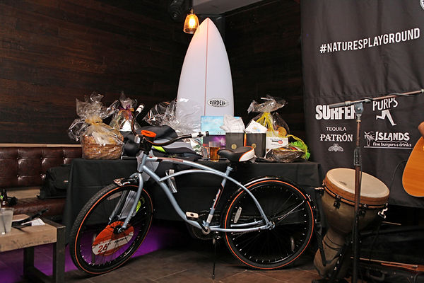 Surf and Golf Charity Event Young and Brave Foundation surfboard and bicycle raffle prize and giveaways