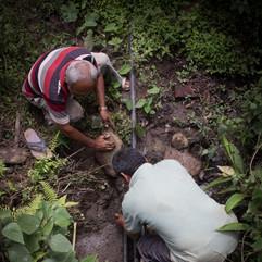 Pipes being repaired at Mahadev Daada Village Community