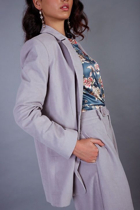 Model close up of our lilac suit set matched with our blue floral blouse