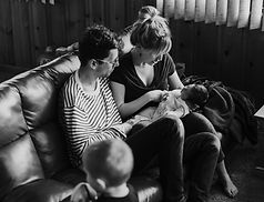 Black and white photo of a family for mindful parent education workshops