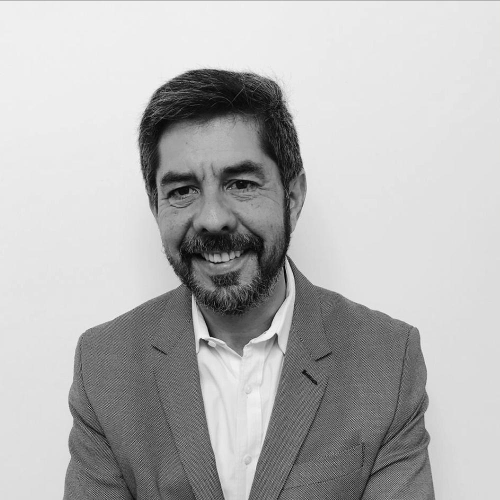 CARLOS E. ALDANA
