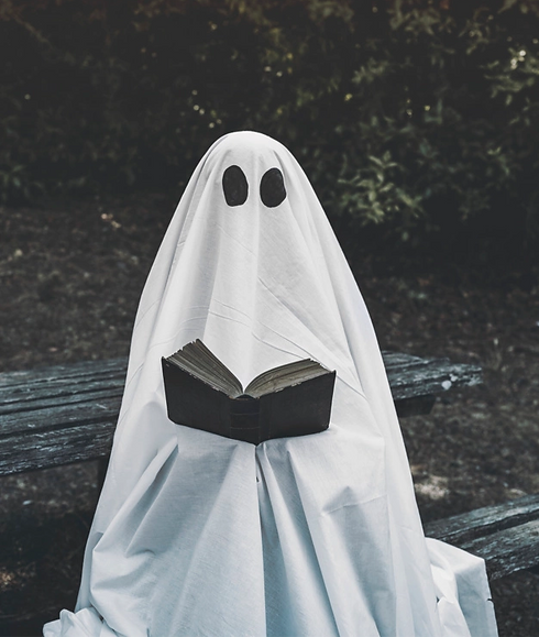 ghost-sitting-bench-reading-book_23-2147905611_edited.png