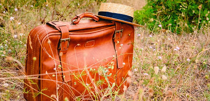 vintage-old-brown-suitcase-surrounded-by
