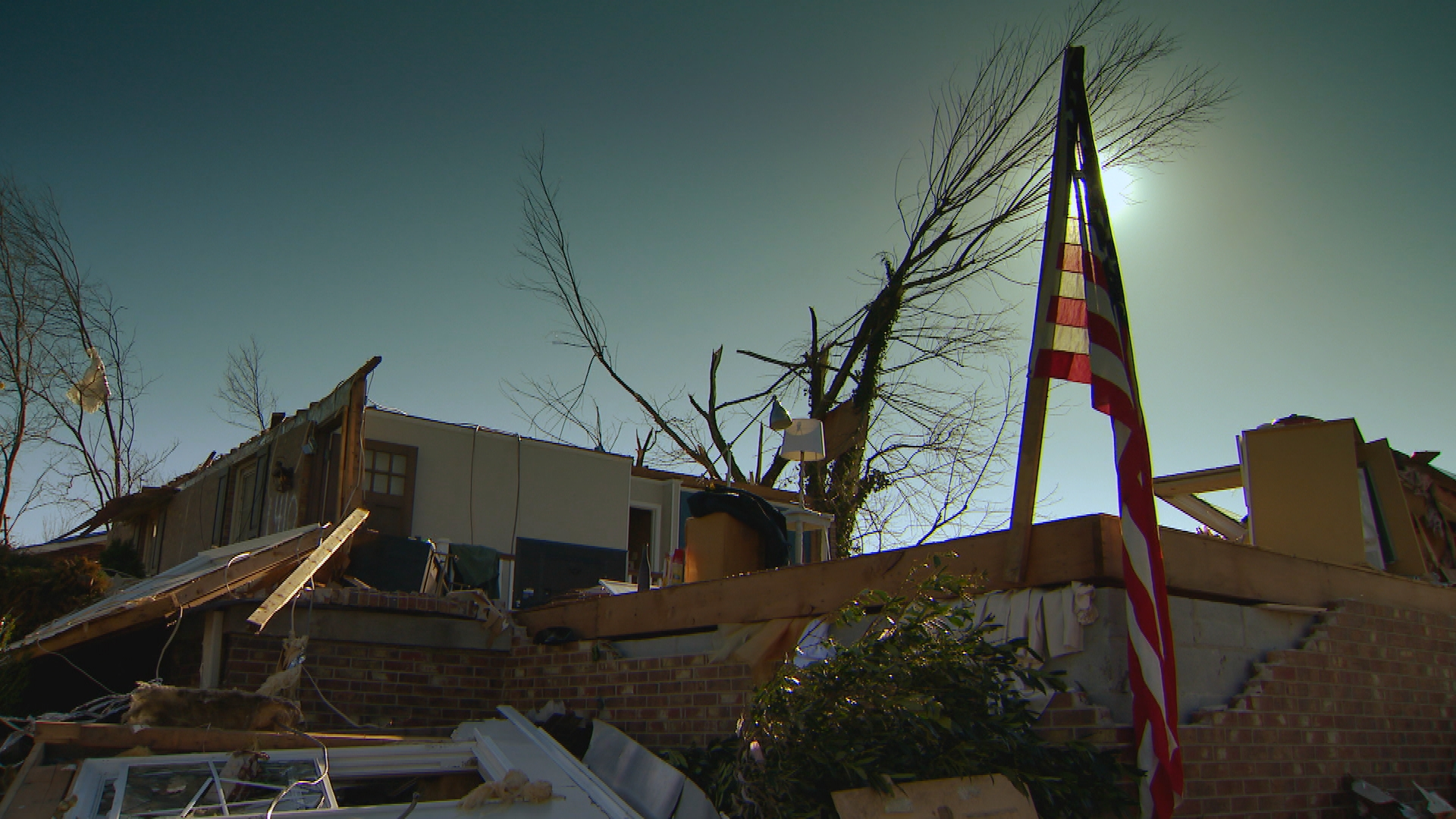 Flag among tornado damage