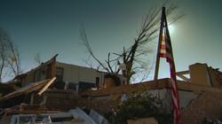 Flag among tornado damage
