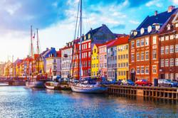 Scenic summer sunset view of Nyhavn pier