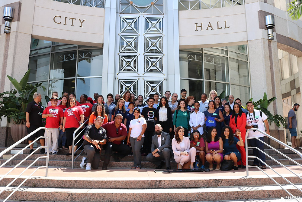 Members of the TRUST Orlando Coalition, following the vote in City Hall.