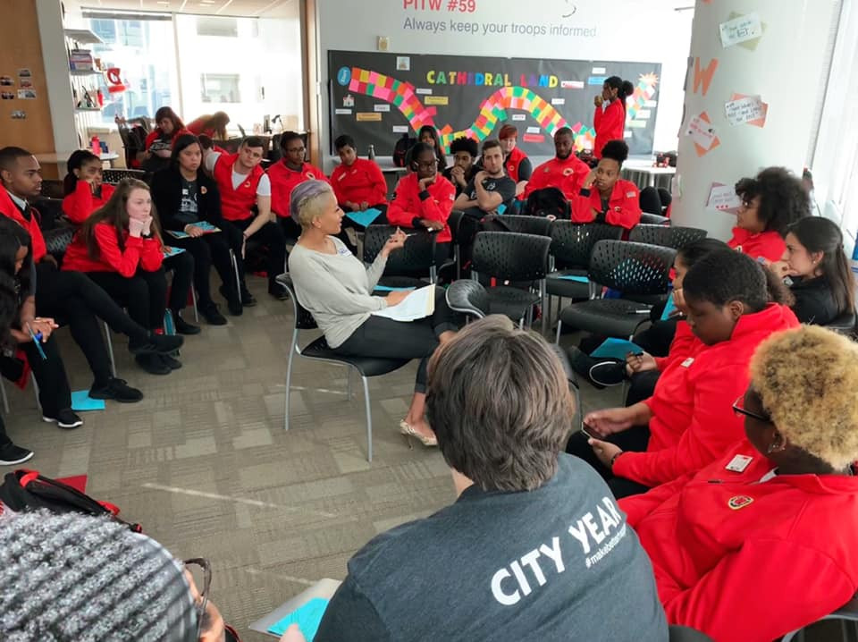 QLatinx Executive Committee Member Gabriella Rodriguez is presenting leading a discussion with the City Year Orlando cohort about addressing unconscious bias.