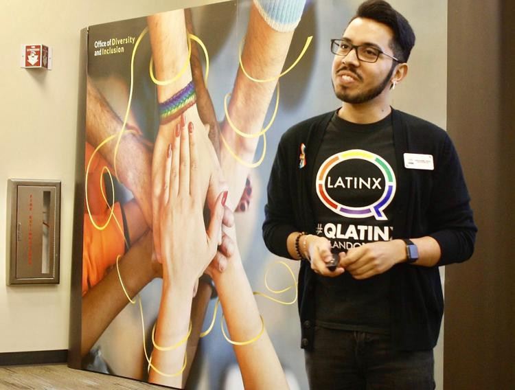 Christopher Cuevas, executive director from QLatinX, talks to UCF students, staff and faculty about Latin culture on Tuesday, Oct. 2. Cuevas explained how the LGBTQ+ community can intersect with the Latin community.