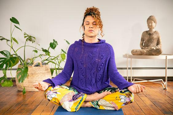A genderfluid person meditating.jpg