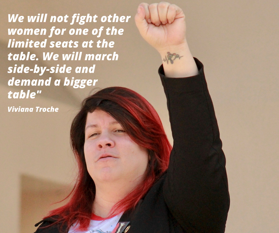 """A photo of Viviana Troche with the quote """"we will not fight other women for one of the limited seats at the table. We will march side-by-side and demand a bigger table"""""""