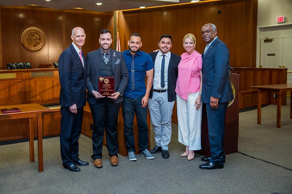Morales, Gov. Scott, Bondi are featured in the photo above.