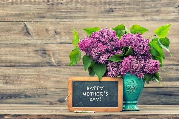 Lilac flowers and vintage blackboard wit