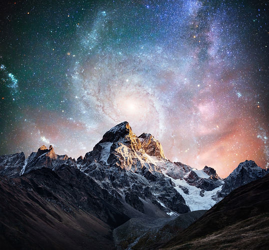 Fantastic starry sky. Snow-capped peaks.