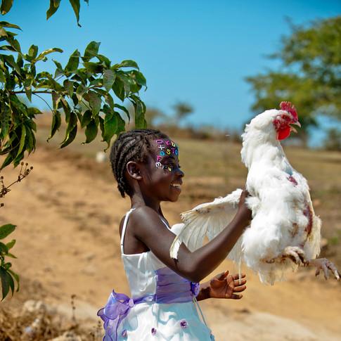 Judith walks with chicken