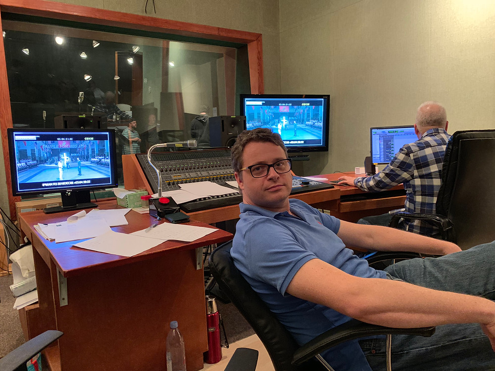 Russell Wait sits in a chair in the studio control room.