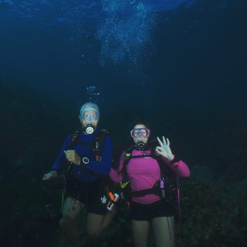 Underwater, notice no wetsuits!