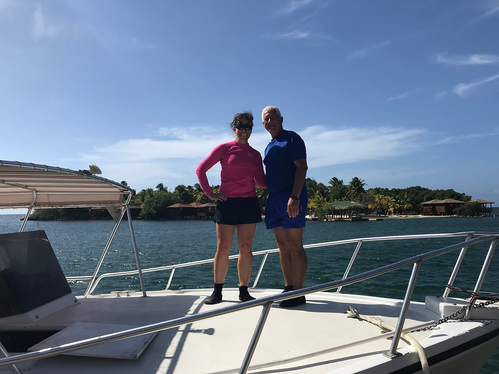 My dad and I on our scuba boat.