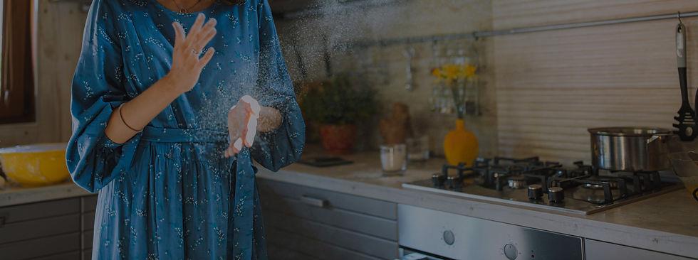 woman-in-blue-dress-standing-in-kitchen-