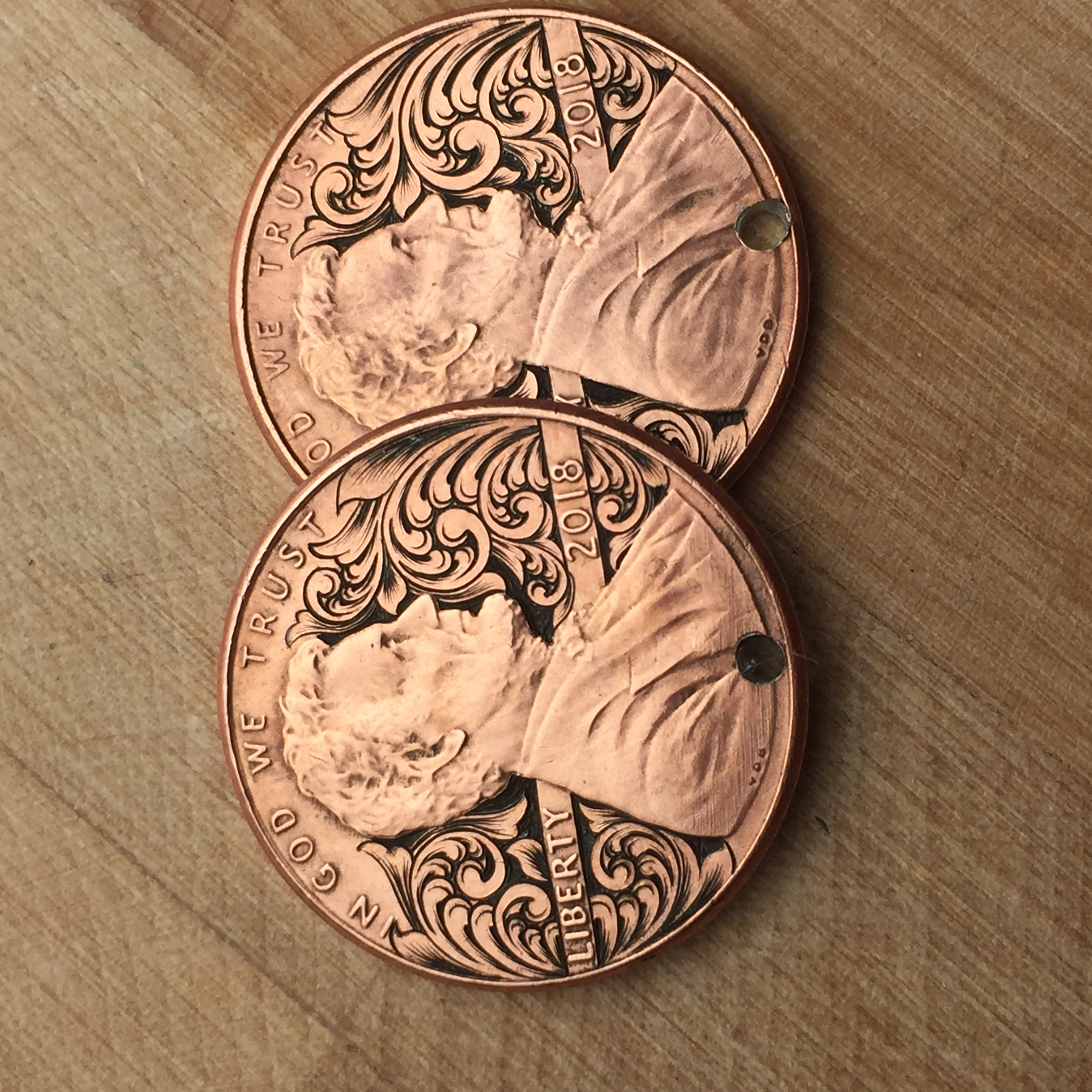 2 hand engraved pennies