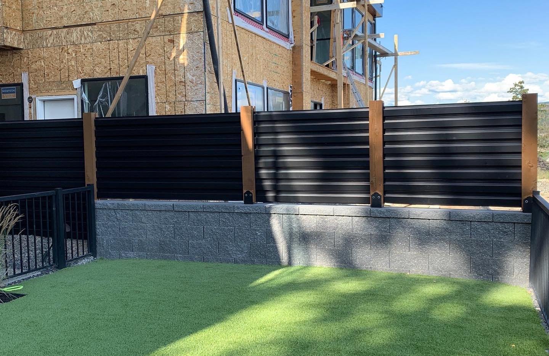 Black corrugated on concrete.JPG