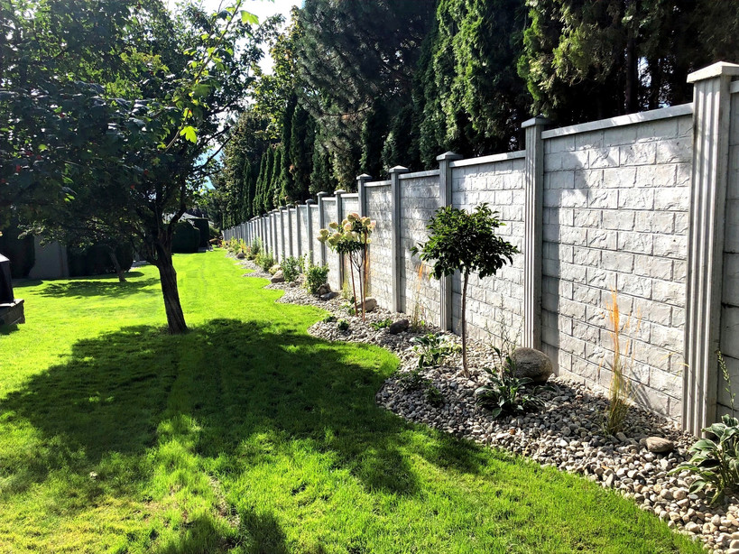 Concrete fence with landscaping