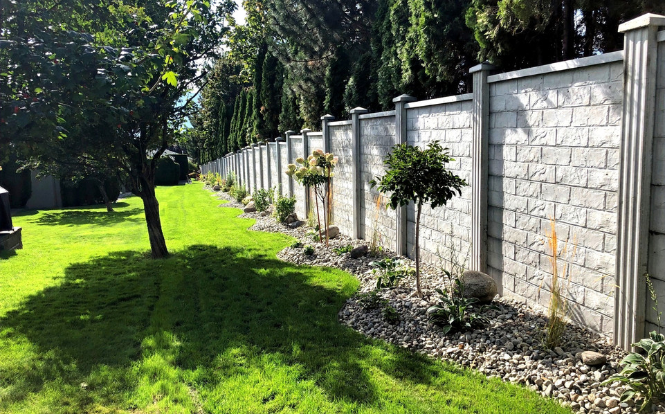 Concrete fence with landscaping.jpg
