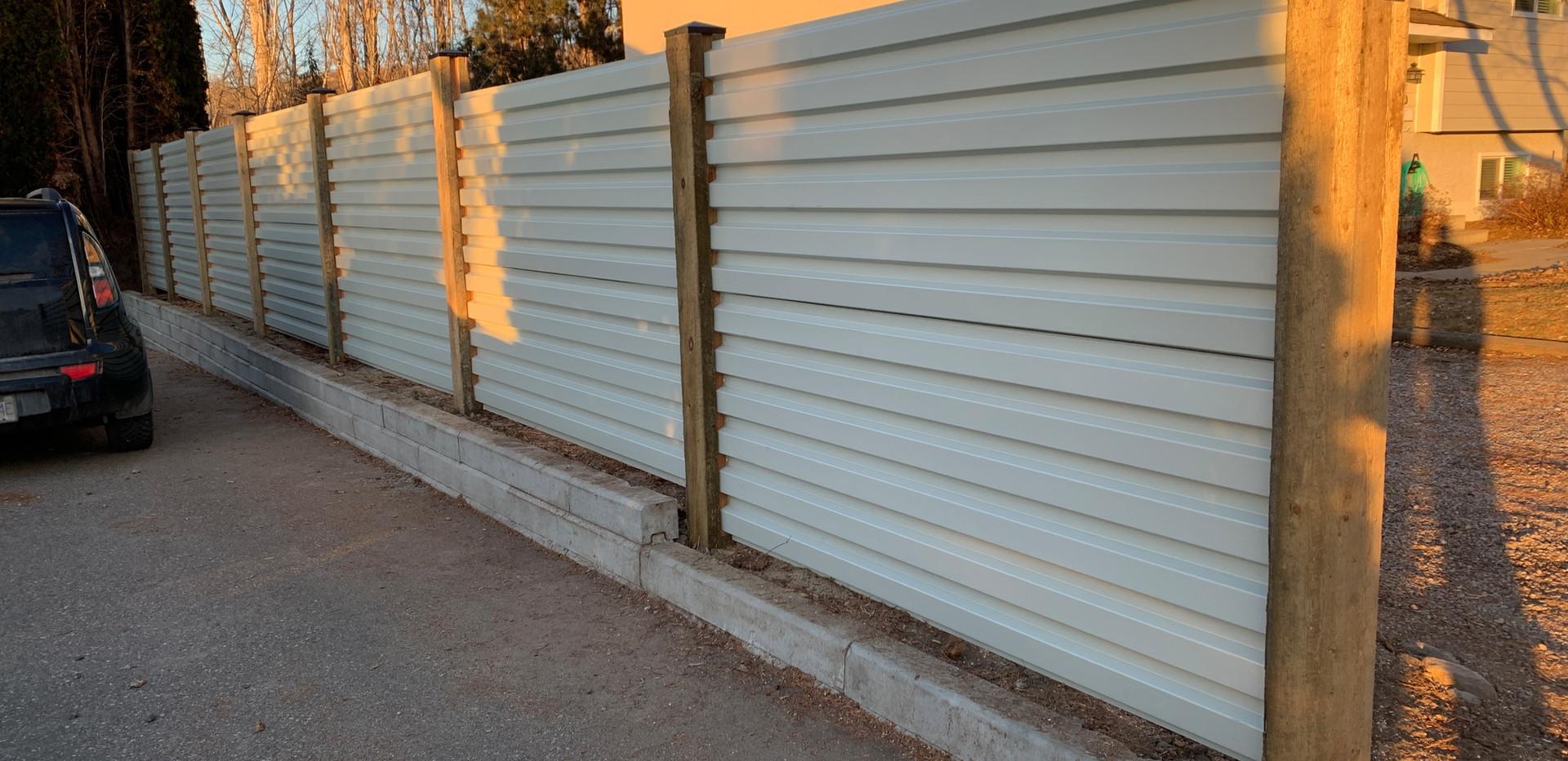 White corrugated metal fence
