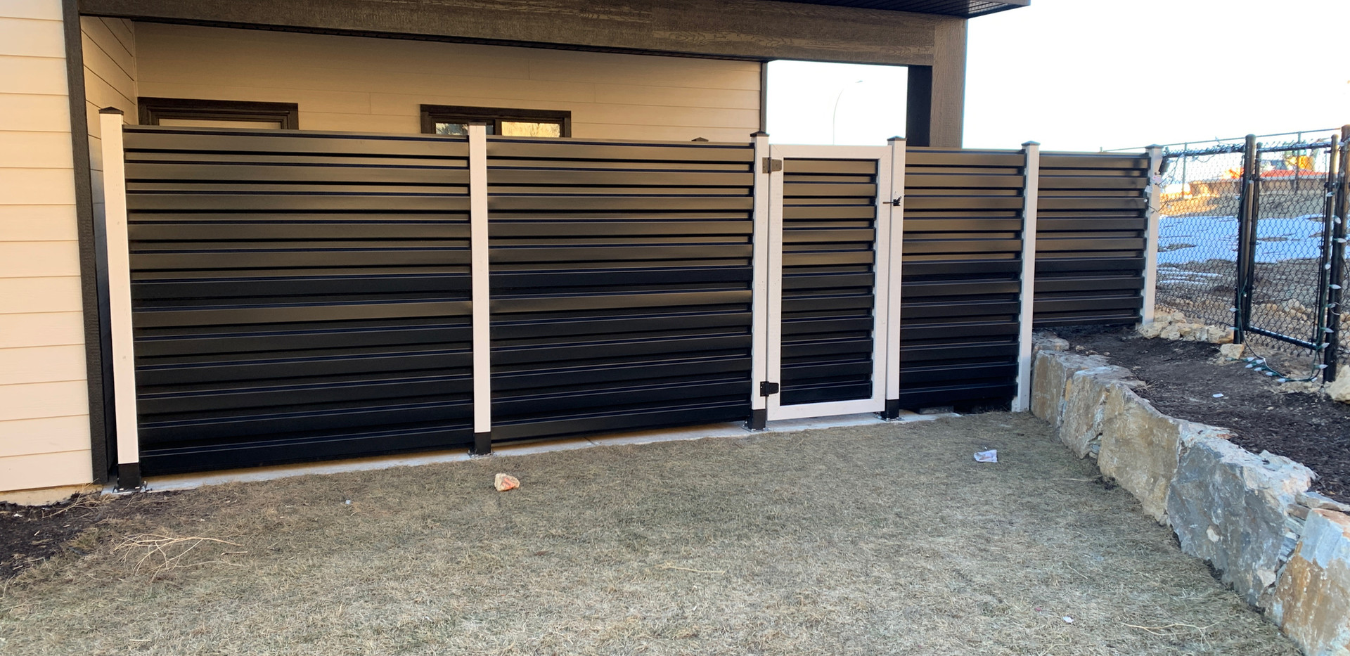 Black and white corrugated metal fence