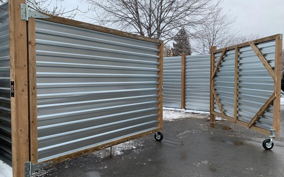 Corrugated metal rolling gates