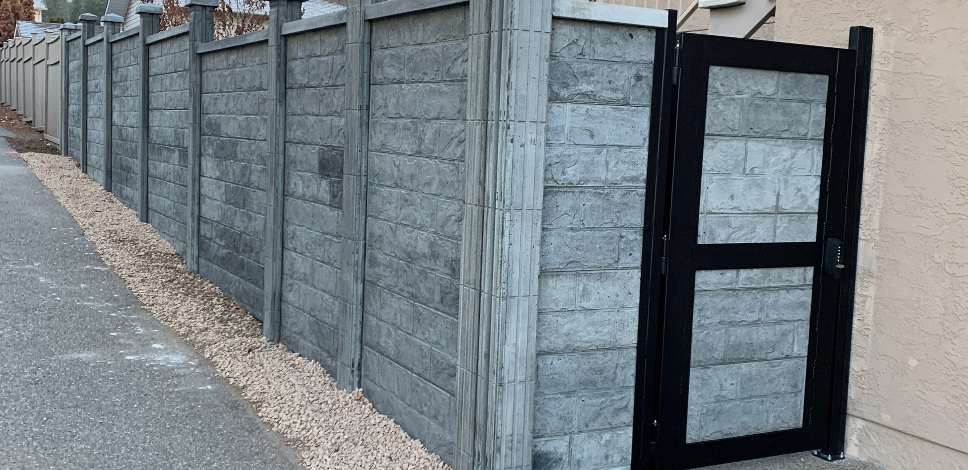 Concrete fence and gate