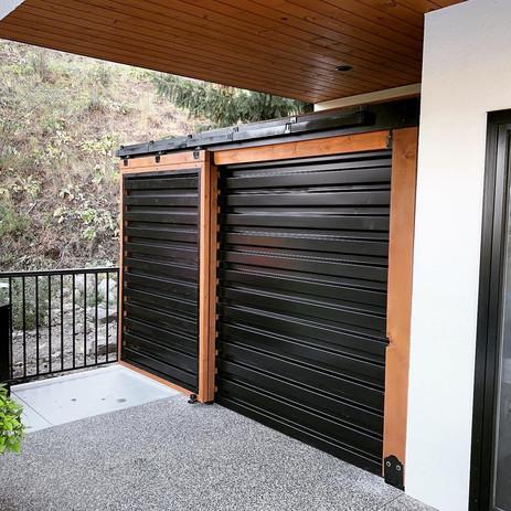 Corrugated barn door style fence
