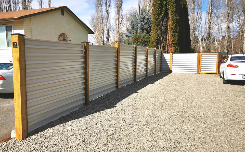 Off white corrugated fence