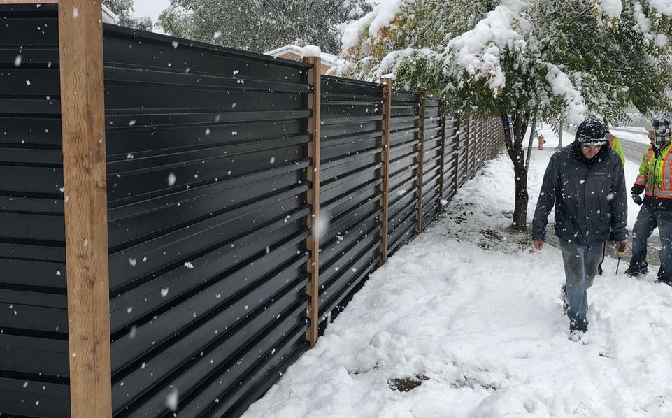 Black corrugated fence