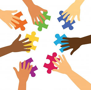 many-hands-holding-colorful-puzzle-piece