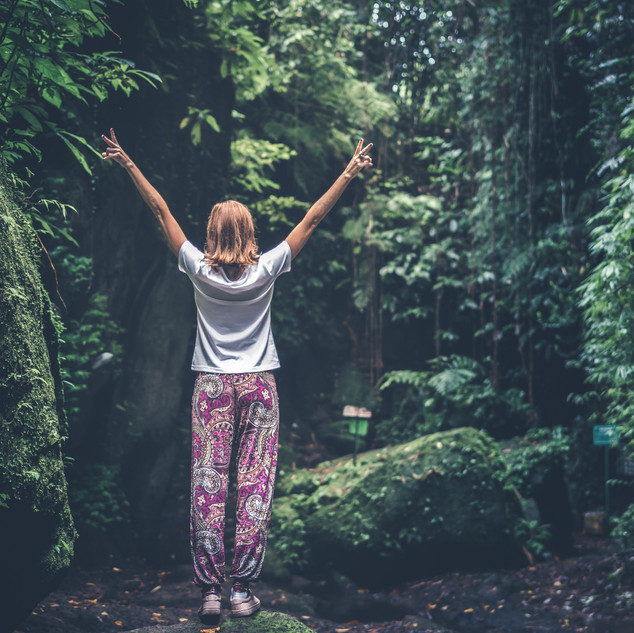 woman-with-raising-arms-facing-pathway-b